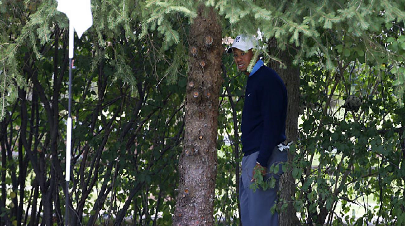Video showed that Tiger Woods' ball removed when he removed some twigs near it on the first hole, which resulted in a two-shot penalty after the round.