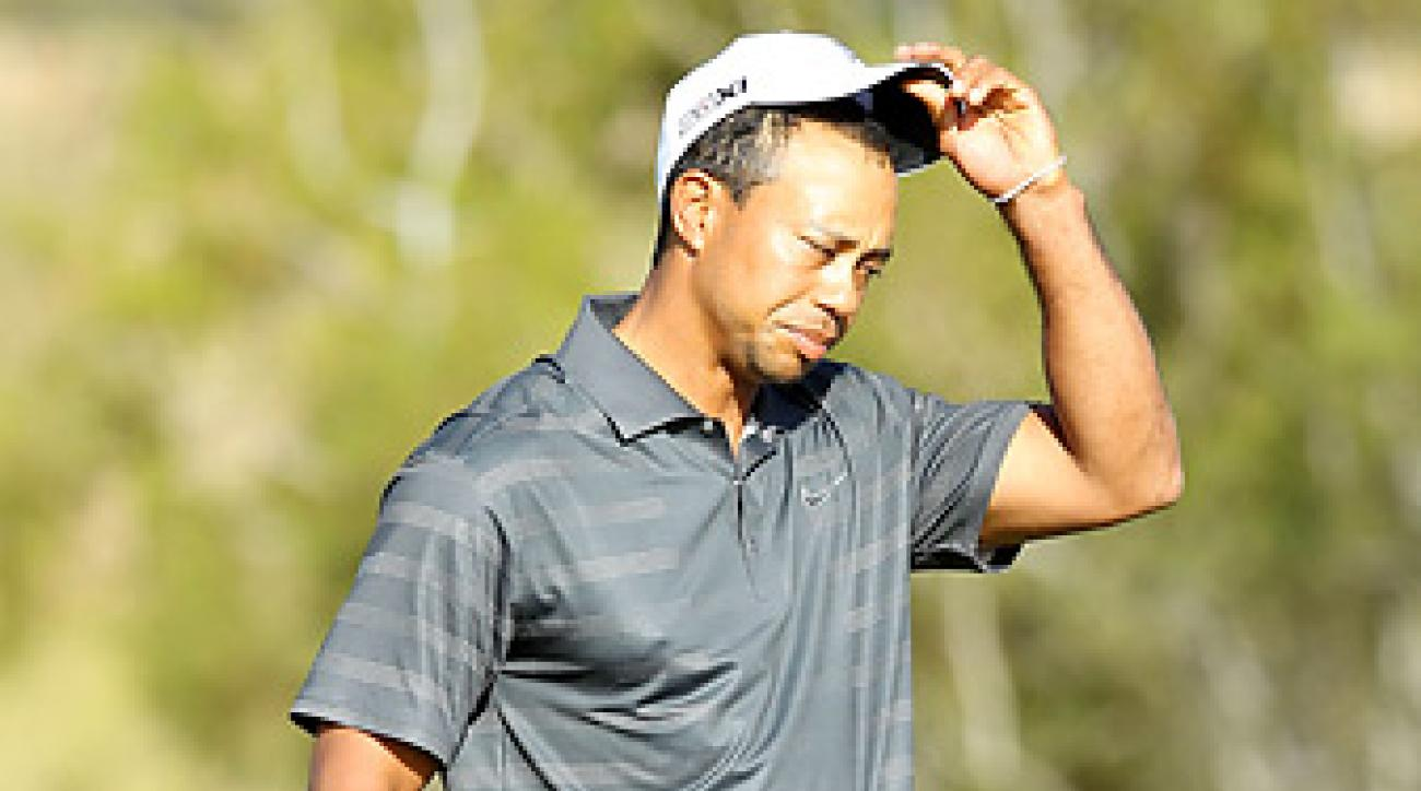 Tiger Woods reacts after missing a 5-foot birdie putt on the 18th hole.
