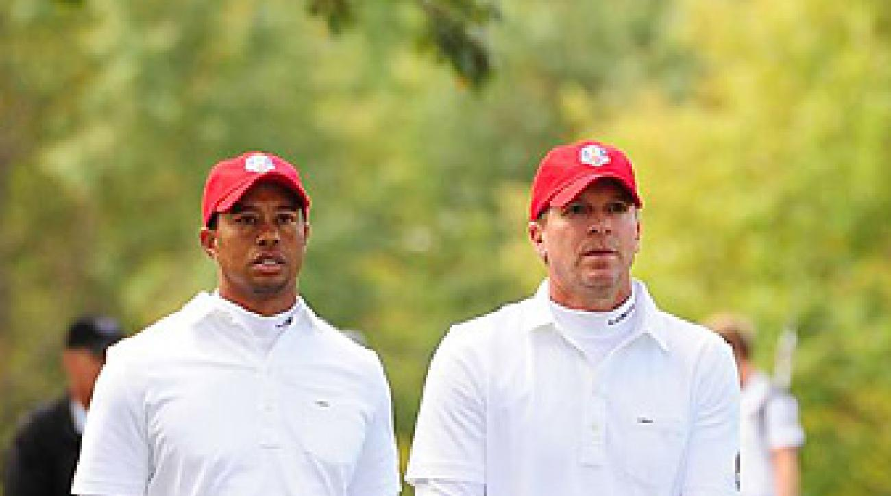 Tiger Woods and Steve Stricker went 0-2 at a team on Friday at Medinah.