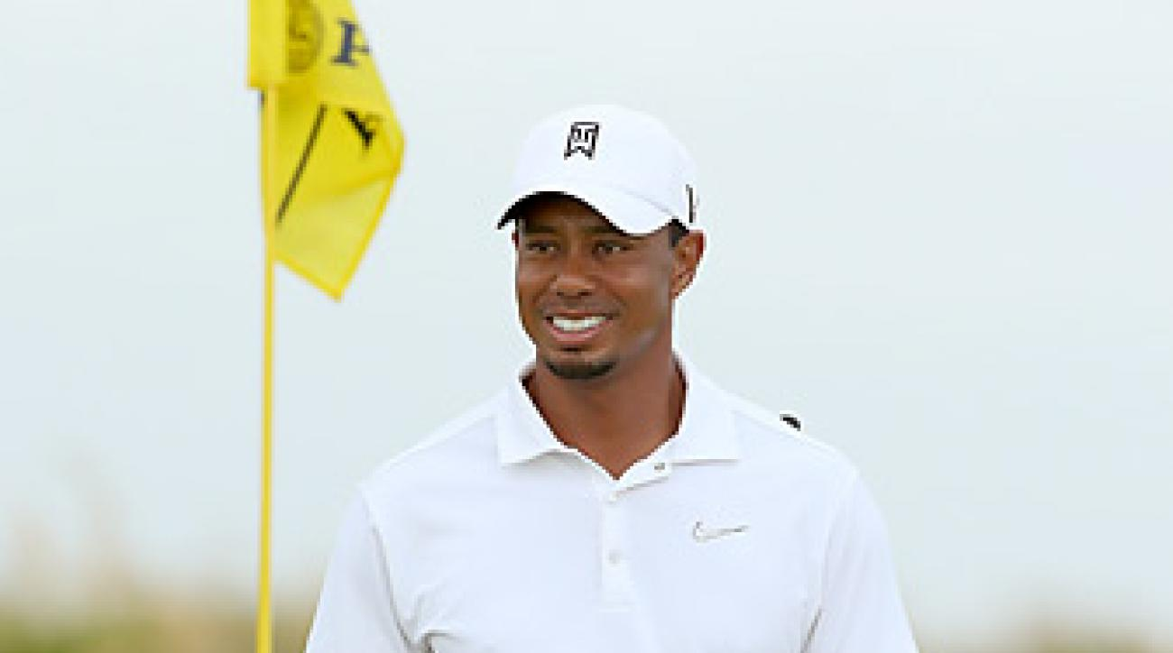 Tiger Woods with face Gonzalo Fernandez-Castano of Spain in the opening round.