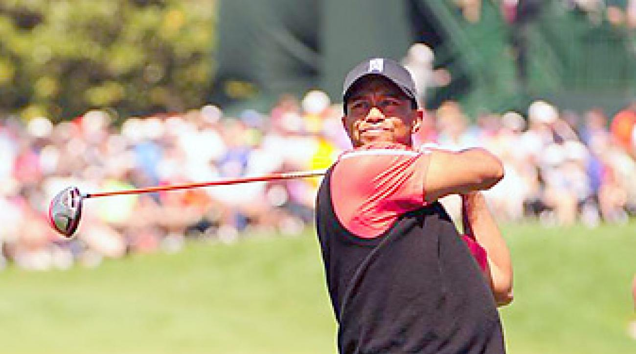 Tiger Woods closed with a 2-under 70 for a five-shot win over Graeme McDowell.
