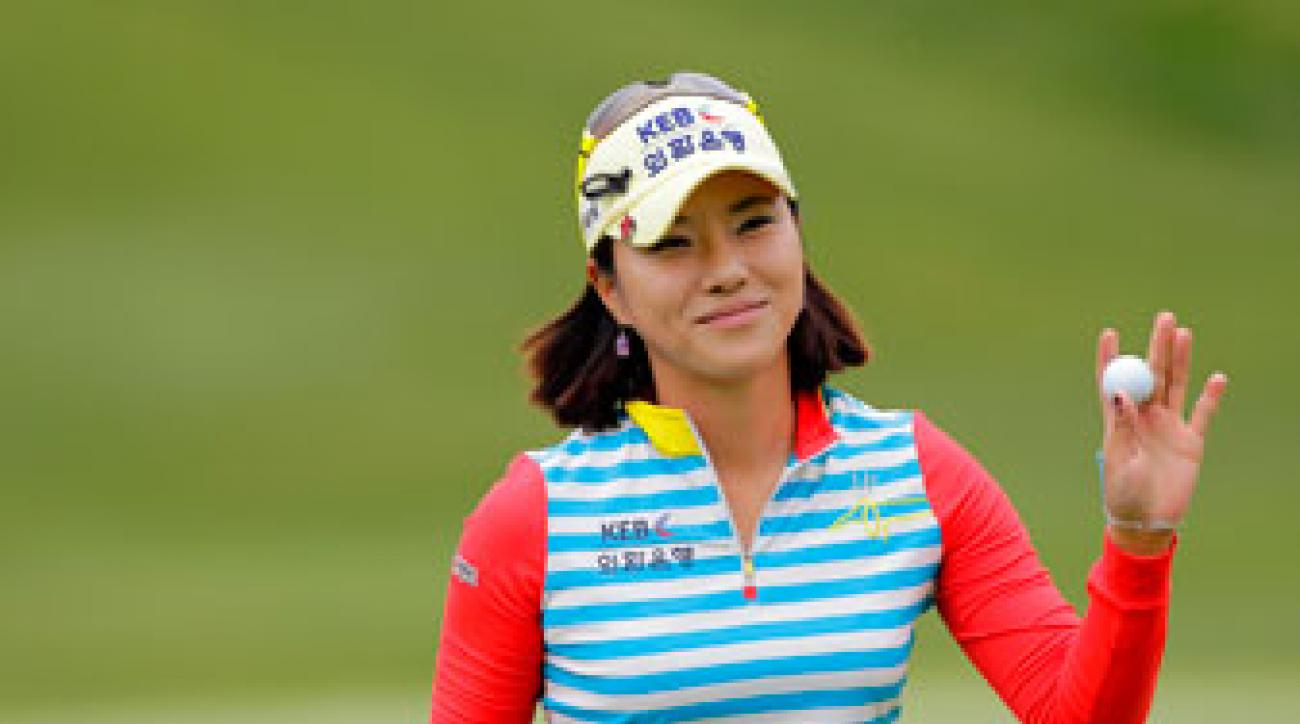 Hee Young Park of South Korea waves to the crowd on the ninth hole during the second round of the Kingsmill Championship.