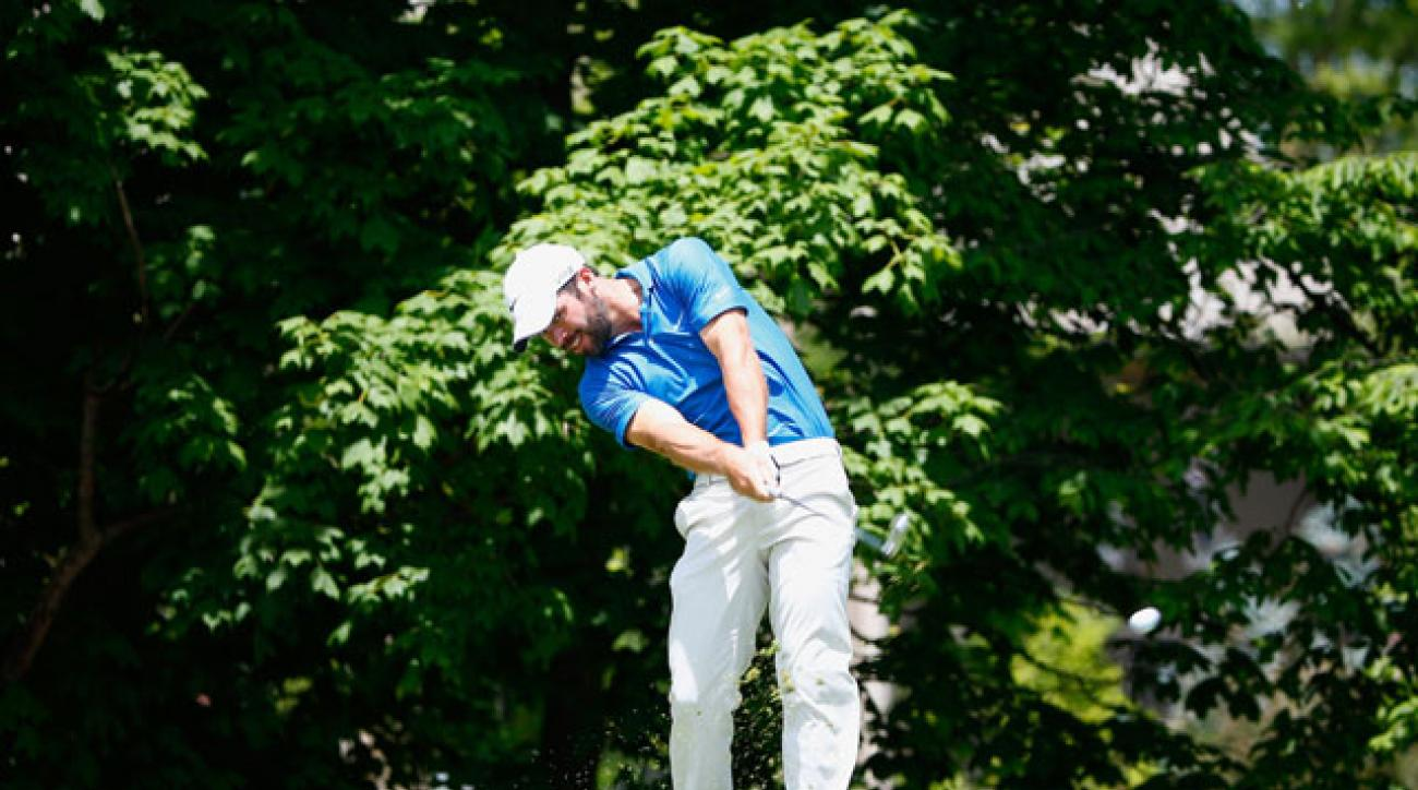 Paul Casey hits a tee shot on the 14th hole during his second consecutive 66 at the Memorial Tournament.