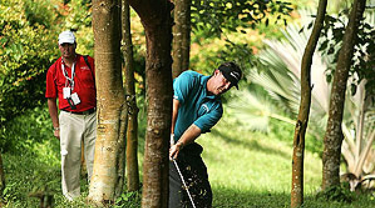 Mickelson's wayward driving let him see plenty of Singapore's thick woods.
