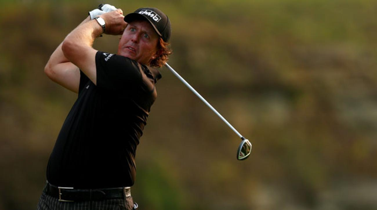 Phil Mickelson of the United States hits his tee shot on the 15th hole during the final round of the 96th PGA Championship at Valhalla Golf Club.
