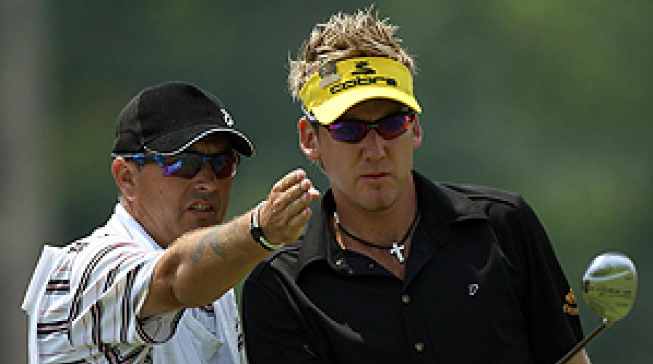 With the help of his caddy, Terry Mundy, Ian Poulter shot a 72 on Saturday.