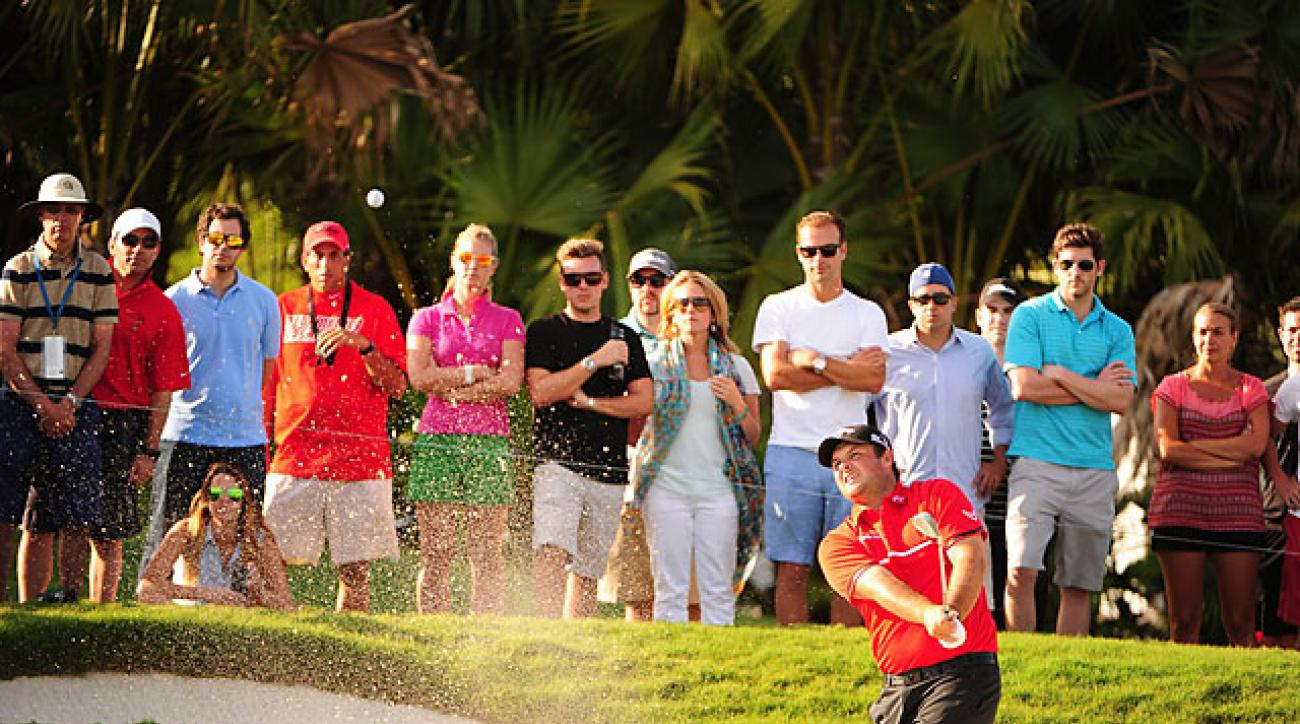 Patrick Reed blasts out of a bunker during the fourth round of his victory at Doral.