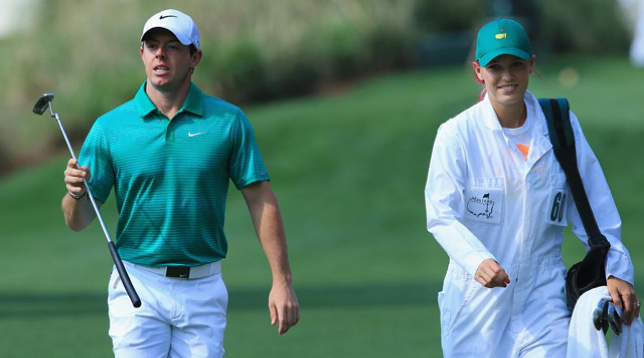 Caroline Wozniacki caddied for Rory McIlroy at the Par 3 Contest prior to the 2014 Masters.
