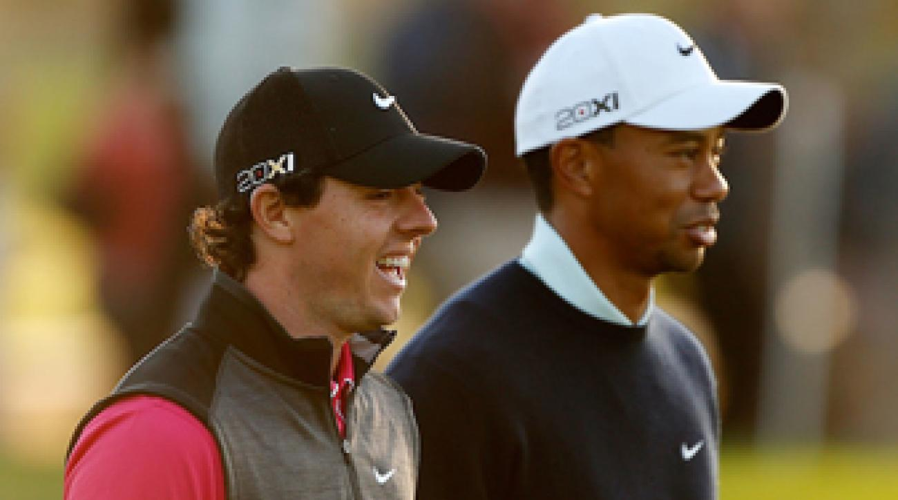 Rory McIlroy and Tiger Woods at the 2013 HSBC Abu Dhabi Championship.