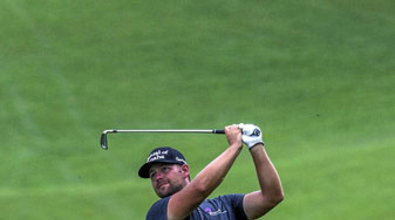 Ryan Moore is in good position to defend his title at the CIMB Classic in Kuala Lumpur.