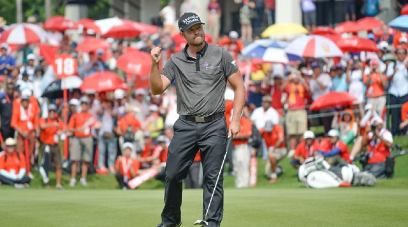 Ryan Moore celebrates on the 18th green after winning the CIMB Classic in Kuala Lumpur.