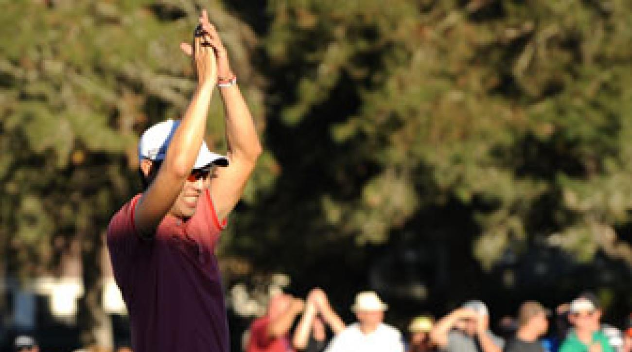 Sang-moon Bae celebrates on the 18th green following his two-shot victory at the 2014 Frys.com Open.