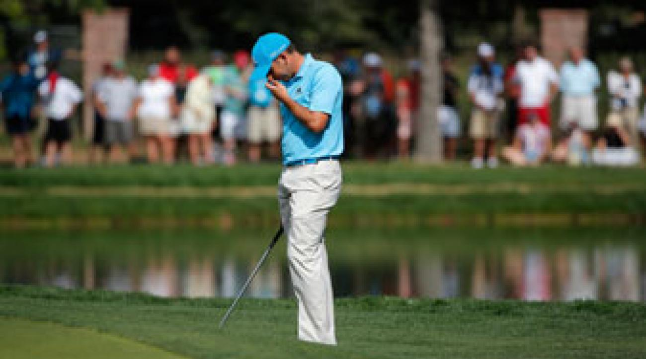 Sergio Garcia reacts to his chip into the water on 17 during the final round of the BMW Championship.