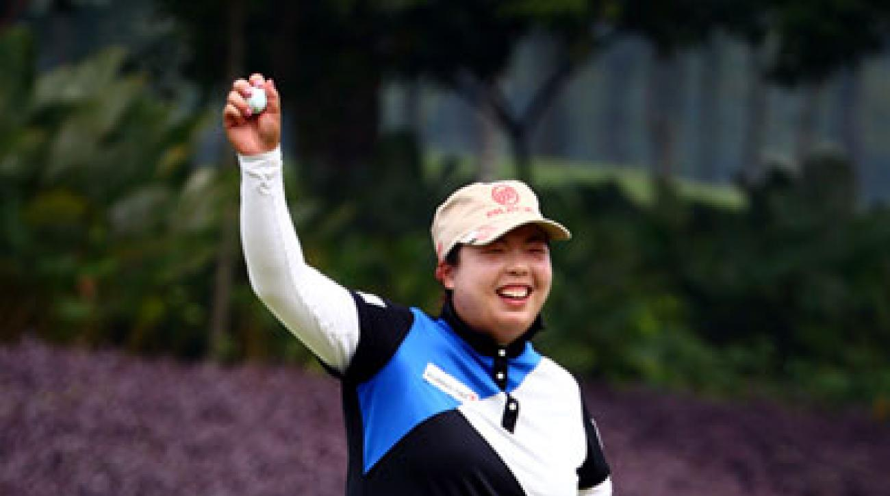 Shanshan Feng celebrates on the 18th green after winning the LPGA Malaysia.