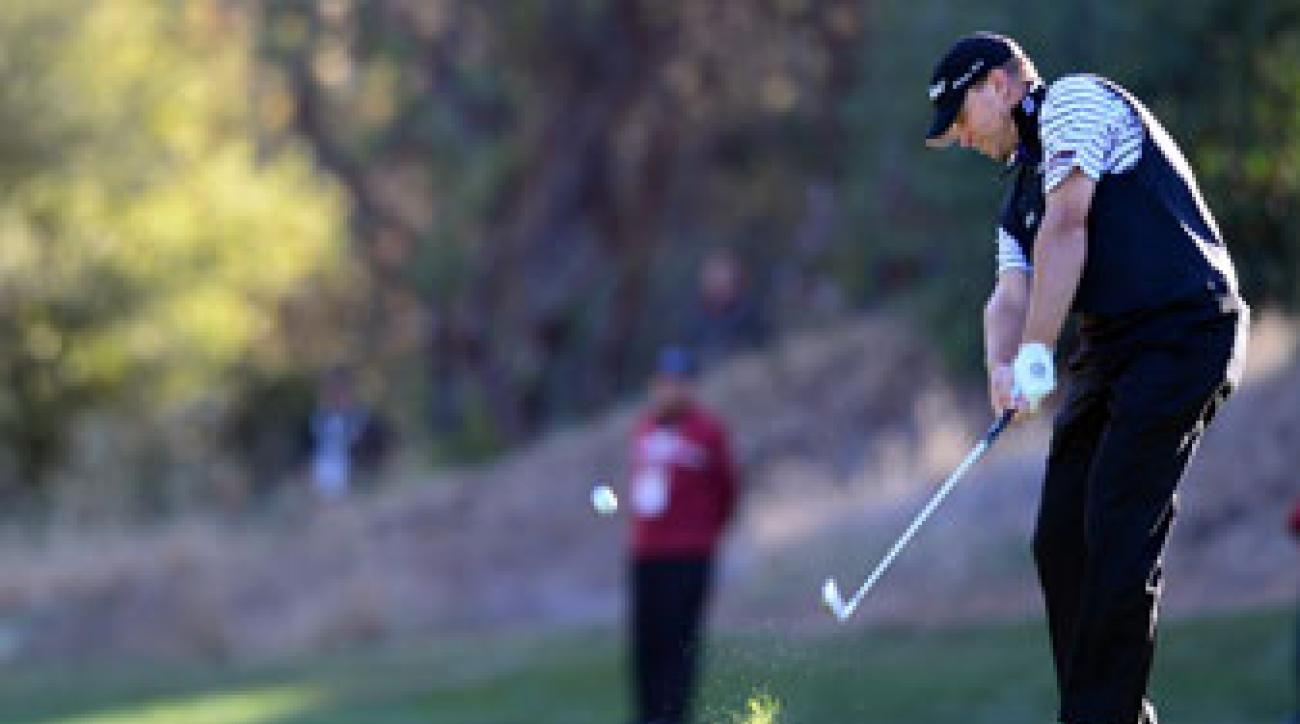 Steve Stricker plays a shot onto the green at the 18th hole during the Northwestern Mutual Challenge golf tournament in December.