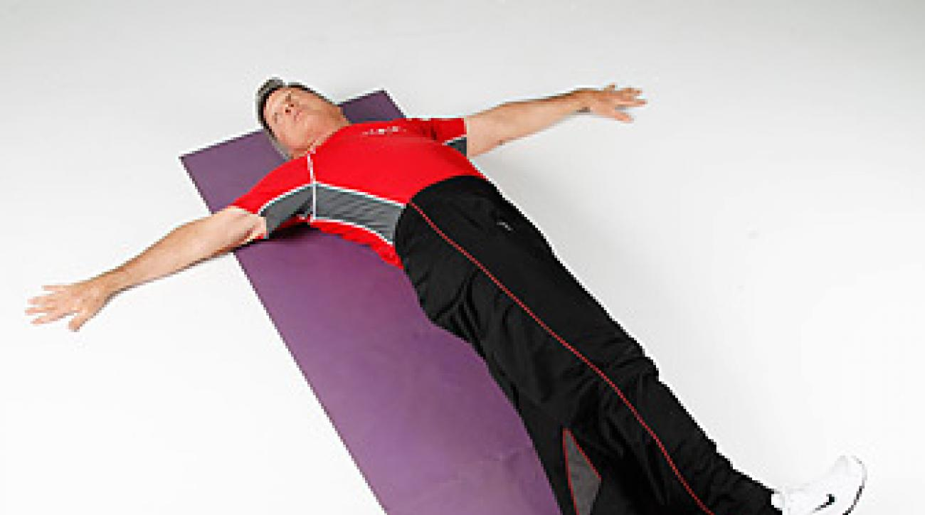 """Roger Fredericks demonstrates the """"crocodile twist,"""" which is designed to help you reestablish the balance in both sides of your body."""