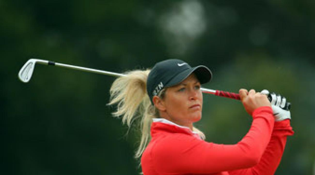 Suzann Pettersen plays an approach shot in the first round of the Australian Open at The Victoria Golf Club.