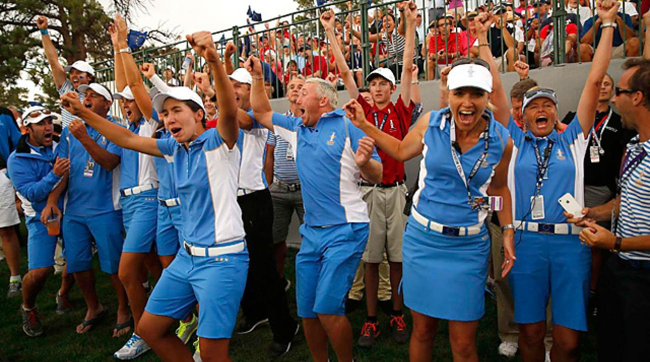 European players and assistants celebrated an 18-10 runaway victory at the Solheim Cup.