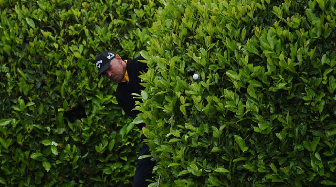 Thomas Bjorn plays out of the bushes during day three of the BMW PGA Championships at the Wentworth Club.