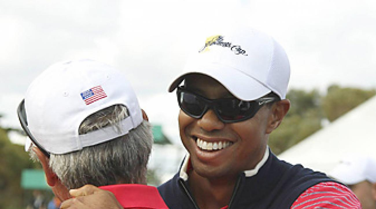 Tiger Woods shared a moment with Fred Couples after clinching the Presidents Cup.