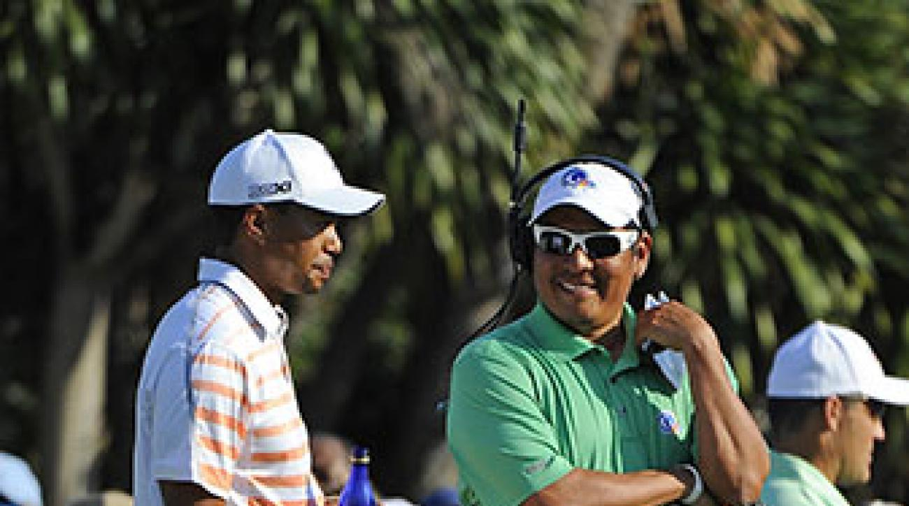 Tiger Woods chats with Notah Begay during the 2013 World Golf Championships-Cadillac Championship at Doral.