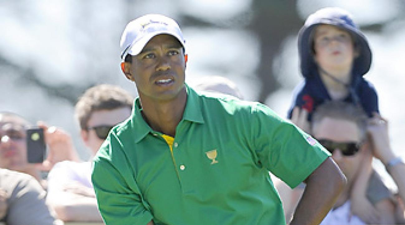 Tiger Woods has a 13-11-1 record in five previous Presidents Cups.