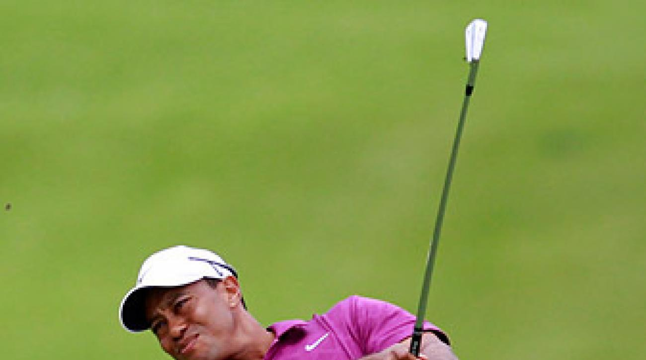 Tiger Woods bounced back from a slow start with birdies at the 8th, 10th, 11th and 13th to get to four under.
