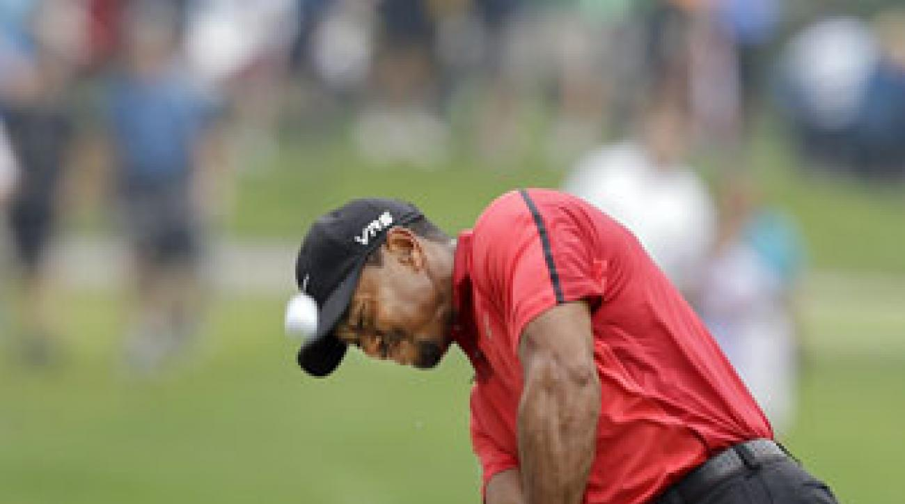 Tiger Woods hits from a fairway bunker during the final round of the WGC-Bridgestone Invitational. He withdrew after eight holes.