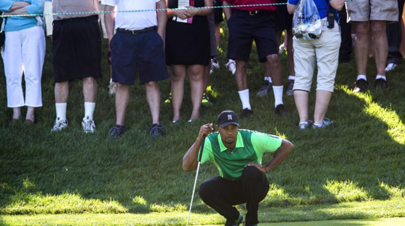 Tiger Woods lines up a putt on the 11th hole during his opening-round 74 at Congressional Country Club.