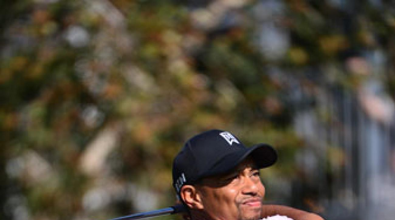 Tiger Woods hits a shot during the first round of the Farmers Insurance Open at Torrey Pines.