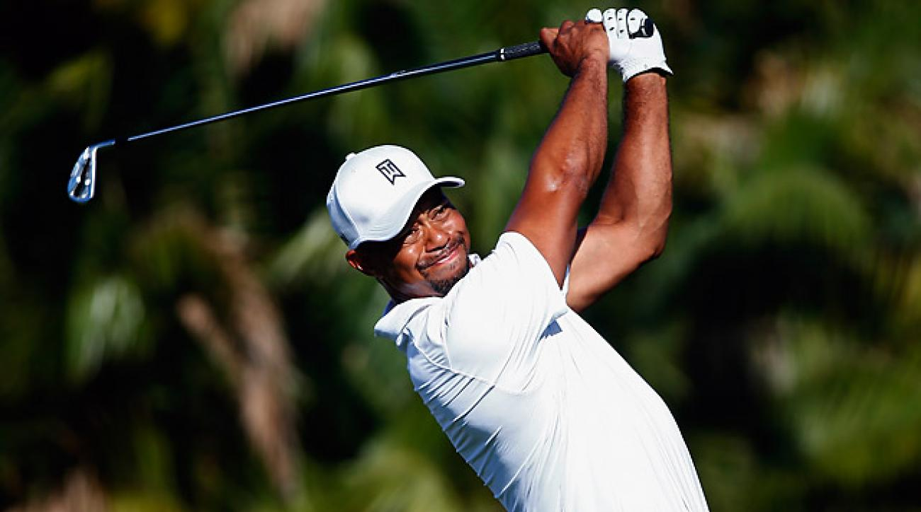 After making the cut on the number, Tiger Woods climbed into the Top 10 before the leaders teed off.