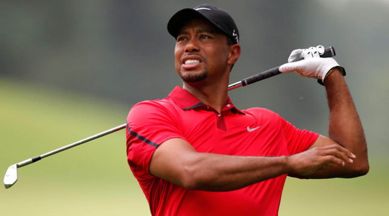 Tiger Woods hits his approach on the third hole during the final round of the WGC-Bridgestone Invitational on Sunday.