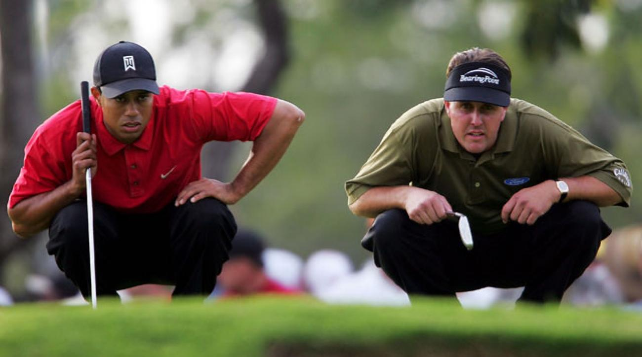 Tiger Woods and Phil Mickelson line up their putts on the 14th green during the final round at Doral in 2005.