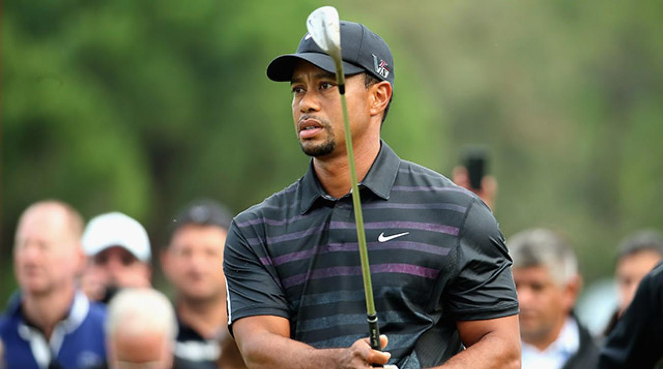 Woods was unable to complete his round after the start of play was delayed for three hours.