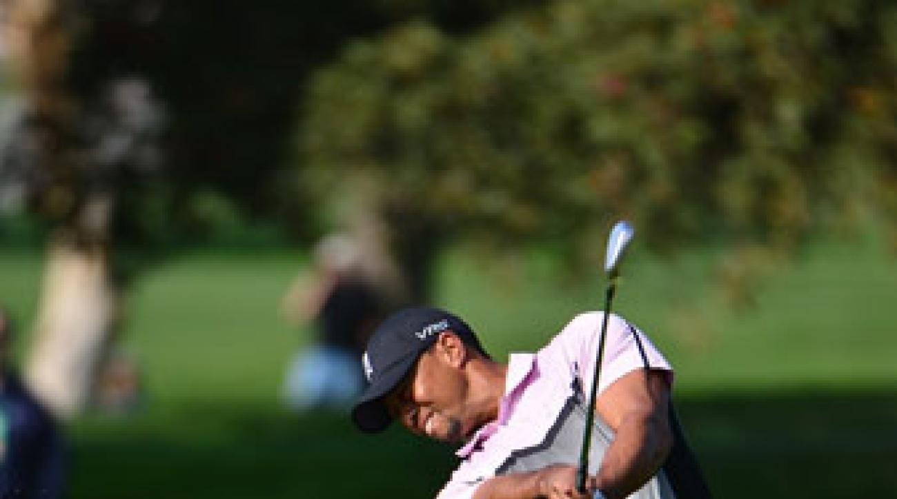 Tiger Woods plays a shot at the Farmers Insurance Open. His iron play is a big reason he's won 14 majors.