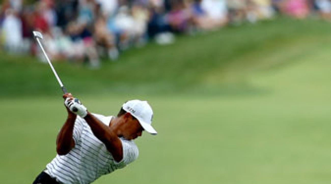 Tiger Woods hits his second shot on the par-5 18th hole during the second round of the PGA Championship.