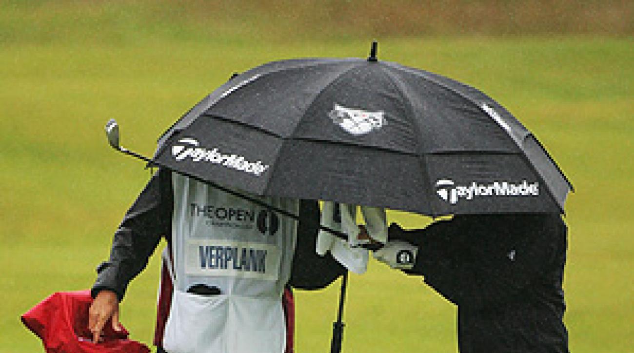 Scott Verplank and his caddy brace against Sunday morning's rain.