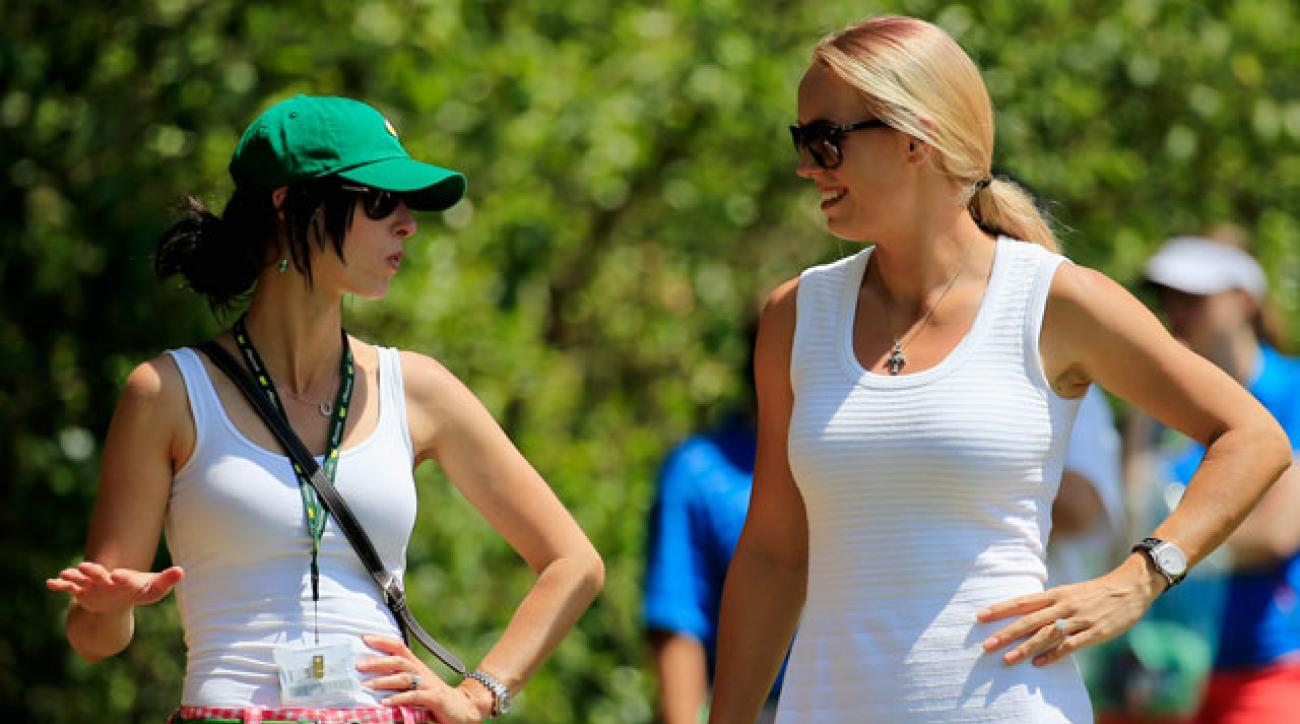 Caroline Wozniacki was back to blonde hair while following fiancé Rory McIlroy at the Masters on Sunday.