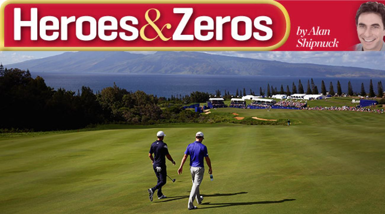 Dustin Johnson and Zach Johnson walk down the 18th fairway during the Tournament of Champions final round.