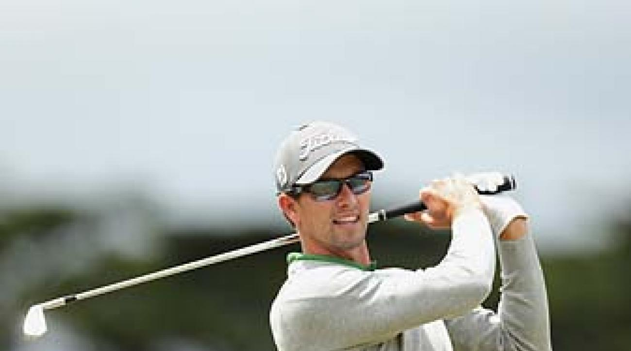 Adam Scott plays an approach shot to the second hole of the Australian Masters at Royal Melbourne on Saturday.