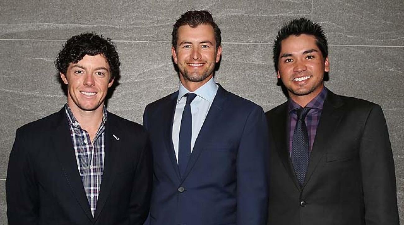 Rory McIlroy, Adam Scott and Jason Day arrive at the official launch of the 2013 Australian Open in Sydney on Wednesday.