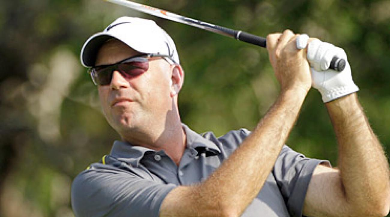 Stewart Cink shot a five-under 67 to tie for the lead after 18 holes.