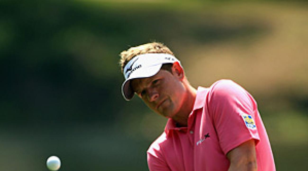 Luke Donald maintained his lead with a solid round of 70 at windy Harbour Town.