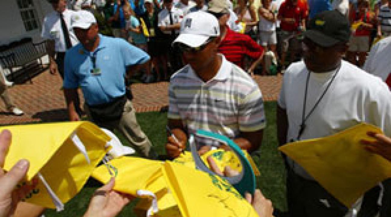 Tiger Woods signed autographs for patrons after his practice round.
