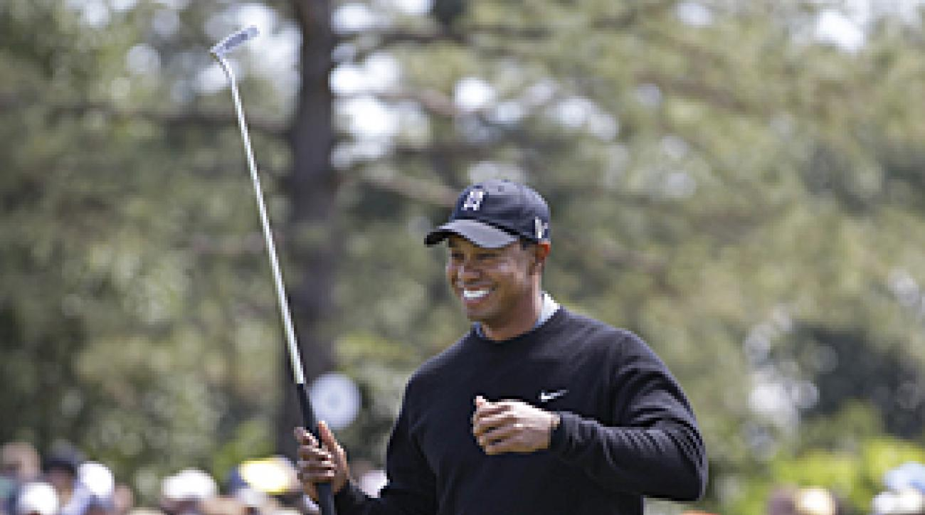 Tiger Woods was absent on Monday, but he got some practice in on Tuesday.
