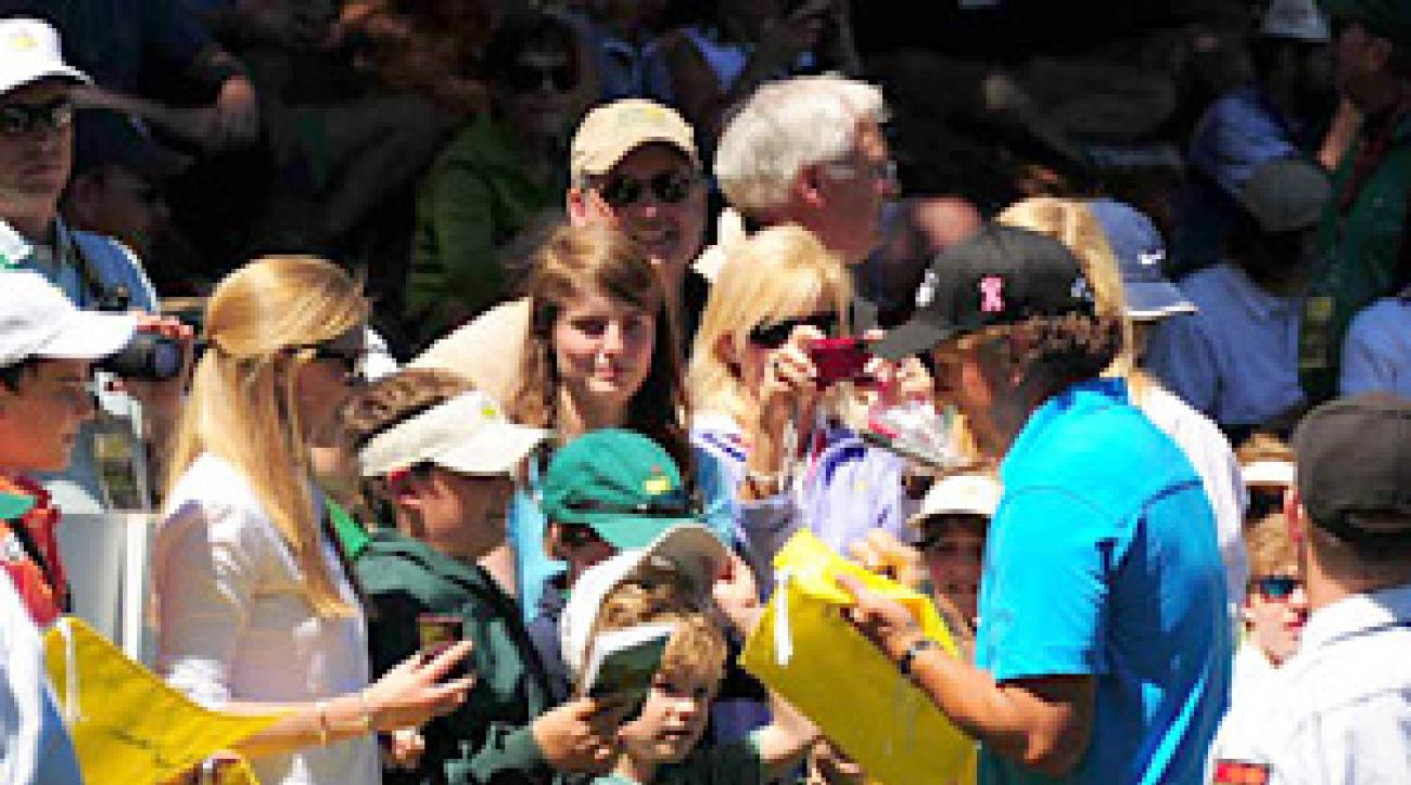 Mickelson took some time to sign autographs during the Par 3 Contest.