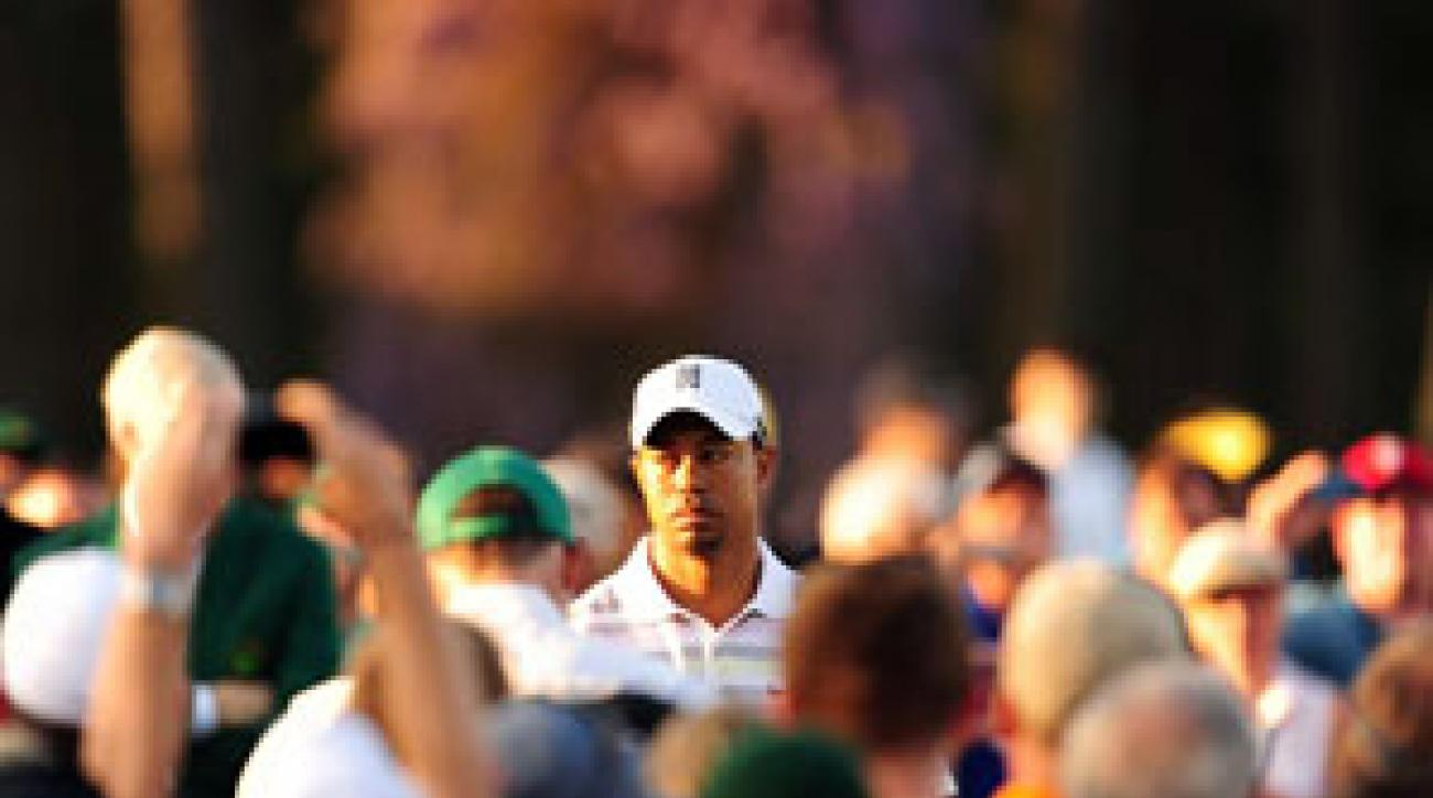 In a hint of what's to come, Woods found a massive crowd awaiting him at Augusta National on Monday when he showed up to play an 8 a.m. practice round.