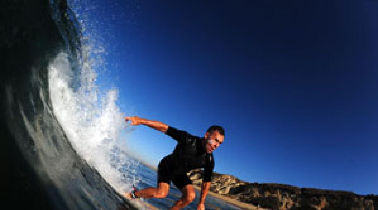 When not grooming swings on the range, Mulligan enjoys carving waves off of Newport Beach, Calif.