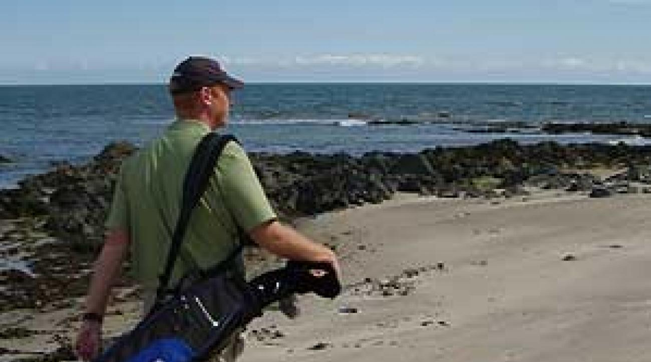 Coyne makes his way across the beach at St. Helen's Bay in Rosslare.
