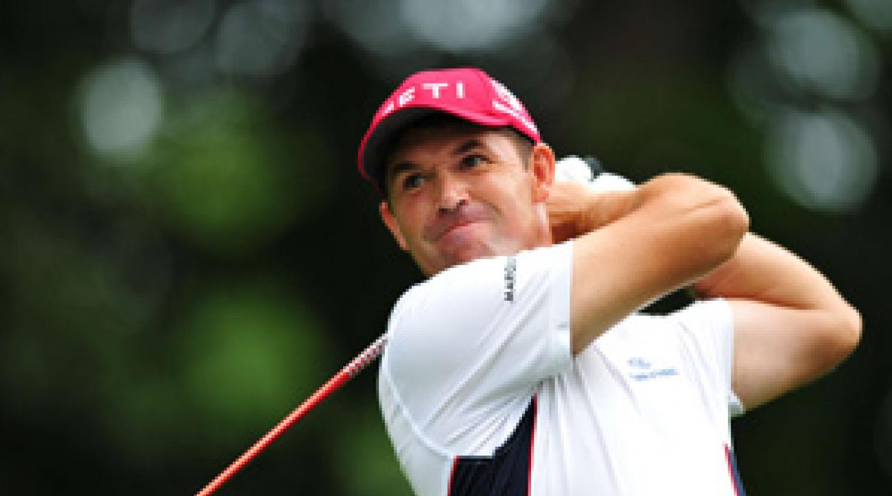 Padraig Harrington bogeyed 18 to drop out of the final group with Tiger Woods.